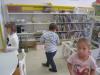 Prvošolci na obisku v knjižnici